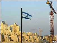 An Israeli flag and cranes over the Maale Adumim settlement