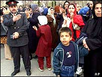 Iranian policeman asks the women to disperse