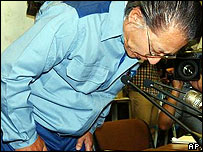 Kansai Electric Power Co. President Yousaku Fuji makes a deep bow at the start of a press conference at its head office at Osaka, Monday August 9, 2004