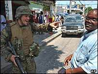 US Marine orders man to cross to the other side of street in central Port au Prince