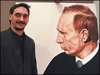 Дмитрий Врубель рядом с нарисованным им портретом президента