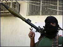 An armed supporter of Moqtada Sadr in Najaf