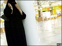 A women talks on a mobile phone in a Saudi shopping centre