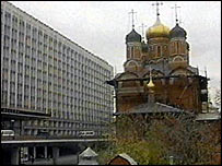 Rossiya Hotel and neighbouring church (still from Russian television)