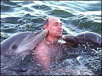 Vladimir Putin plays with dolphins