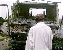 Burnt-out paramilitary vehicle in Wana
