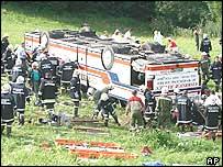Rescue crews surround wreckage of bus