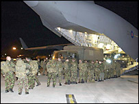 Troops from the 1st Battalion Royal Gloucestershire, Berkshire and Wiltshire regiment board a plane for Kosovo