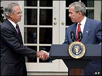 Porter Goss and George Bush shake hands