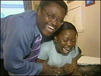 Tope Adeloye (right) is congratulated by her father