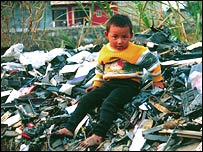 Boy sits on e-waste, Basel Action Network