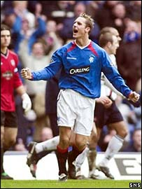 Peter Lovenkrands celebrates the opening goal