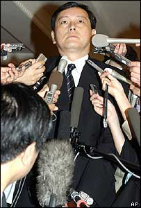 Japan's chief delegate Akitaka Saiki speaking to journalists before leaving his hotel for a meeting with North Korean diplomats in Beijing Thursday Aug. 12, 2004