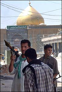 Insurgents stand near the Imam Ali shrine in Najaf