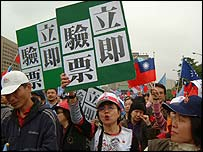Protesters march in Taipei