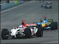 Jenson Button fends off Jarno Trulli