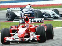 Michael Schmacher had to fend off Juan Pablo Montoya throughout the Malaysian Grand Prix