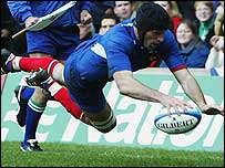 Olivier Magne scores the opening try for France against Scotland