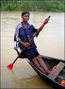 Girl in a dugout canoe in a mangrove swamp in Nigeria's Niger Delta region