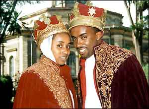 Couple pose in their wedding finery outside an orthodox church in Ethiopia