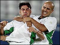 Hawar Mulla Mohammed is mobbed by team-mates after scoring for Iraq