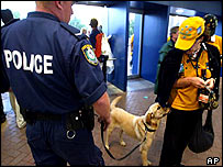 Australian policeman with sniffer dog