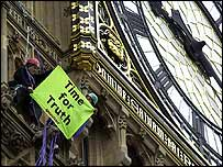 Greenpeace protestors with a banner up Big Ben