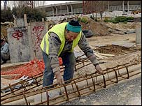 A labourer works near the Olympic Stadium in Athens