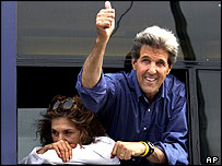 John Kerry gives the thumbs up sign