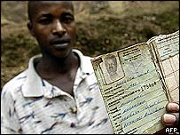 A young Rwandan shows his national ID card,