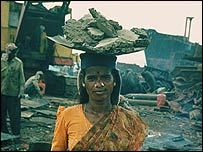 A woman carrying asbestos on her head. Pic: Greenpeace