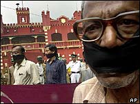 Members of the Association for Protection of Democratic Rights (APDR) stage a silent protest outside the prison where  Chatterjee was executed
