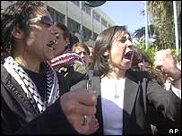 Jordanian women shout slogans against the assassination of Hamas leader Ahmed Yassin during a protest in Amman, Jordan