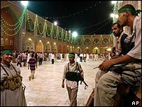 Mehdi Army gunmen rest inside the Imam Ali shrine in Najaf