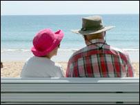 Couple sitting on the beach in Australia