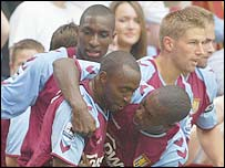 Aston Villa celebrate Darius Vassell's opening goal