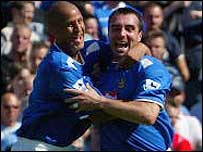 David Unsworth (right) celebrates his penalty equaliser for Portsmouth against Birmingham