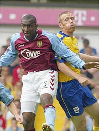 Jlloyd Samuel gets the better of Brett Ormerod
