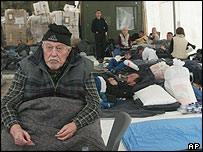 An elderly Serb man waits to be escorted back to his village from a peacekeepers base