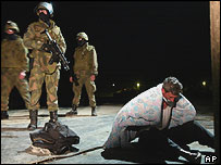 A Kosovo Albanian suspect is gagged and detained by Norwegian peacekeepers early on Tuesday, 23 March