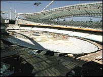 The Olympic Stadium floor, which featured the opening ceremony pool, is taken apart on the first day