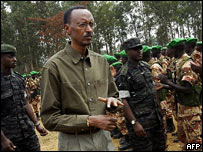 Rwandan President Paul Kagame inspects soldiers in Kigali before they were airlifted to Darfur in Sudan