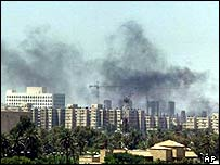 Smoke rises over Baghdad after a mortar attack during the conference