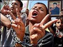 Palestinian youths demonstrate in Beit Hanoun to call for the release of Palestinian prisoners from Israeli jails
