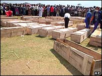 Coffins are prepared for the burial