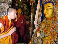The 11th Panchen Lama worships the statue of Sakyamuni during a religious ceremony in the Jokhang Temple in Lhasa