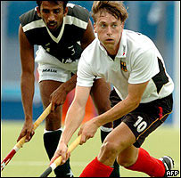 German Christoph Eimer (right) dribbling the ball past Pakistan's Muddasar Ali Khan