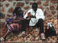 Esther and a boy whose parents took part in the genocide