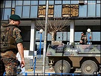 Nato-led Kfor peacekeeping troops guard the United Nation Mission In Kosovo (UNMIK) regional headquarters in Prizren