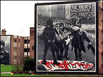 A black and white mural depicting 'Bloody Sunday'